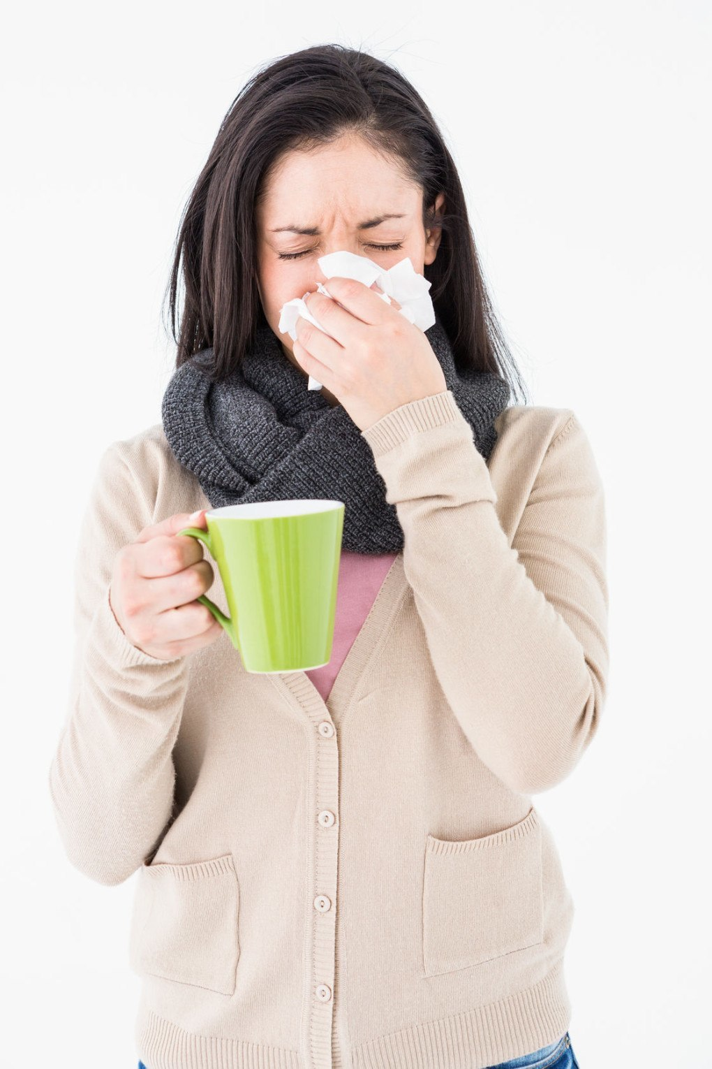 A woman sneezed as she holds her coffee